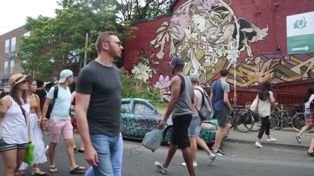 general footage of pedestrian sundays in kensington market in toronto ontario canada on sunday june 26 2016 shots shot of bike parked with many... - animal leg stock videos & royalty-free footage