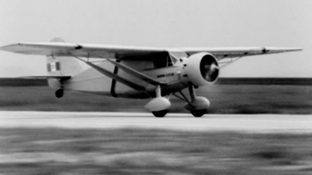 general francesco de pinedo climbs into his plane at floyd bennett field / plane taking off / james mattern climbs into his plane / plane takes off... - 1933 stock videos and b-roll footage