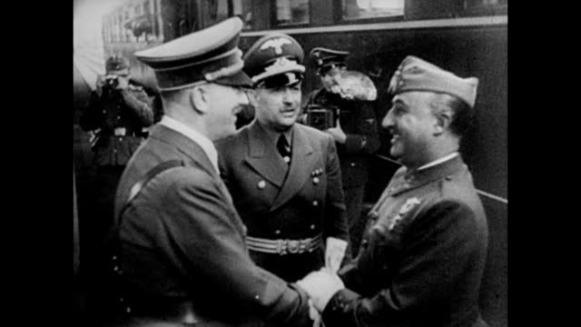 general franco meeting adolf hitler at the franco-spanish border / francisco franco getting off train and shaking hands with adolf hitler during... - adolf hitler stock videos & royalty-free footage