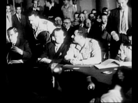 general gamal abdel nasser sits at long table with members of british delegation as man signs treaty regarding british troop withdrawal from the suez... - suez canal stock videos & royalty-free footage