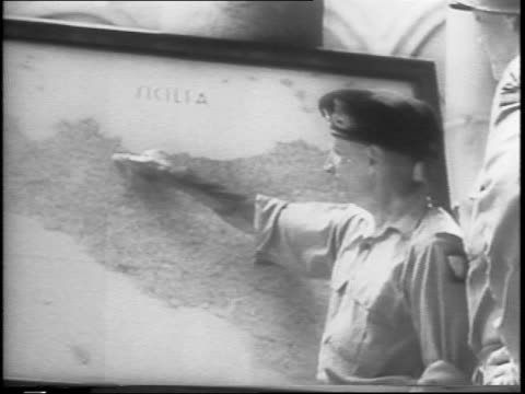 general george patton and field marshal bernard law montgomery saluting as they enter building / patton and montgomery consulting map of sicily /... - 1943 stock-videos und b-roll-filmmaterial
