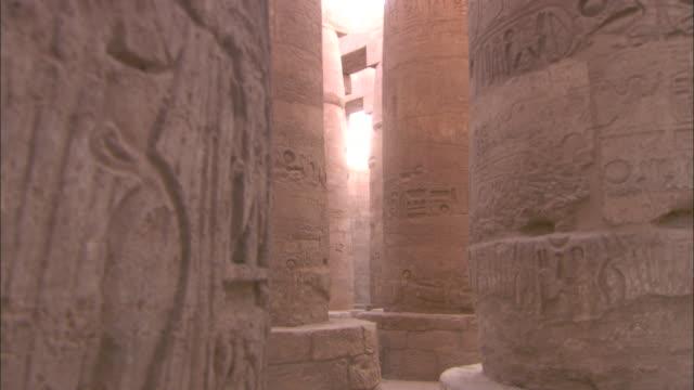 general germanicus walks through the  karnak temple in egypt. - temples of karnak stock videos & royalty-free footage