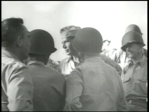 s general holland smith aka 'howlin' mad' talking w/ 4th marine division officers inspecting aftermath of attack on beach world war ii wwii pacific... - marshall islands stock videos & royalty-free footage