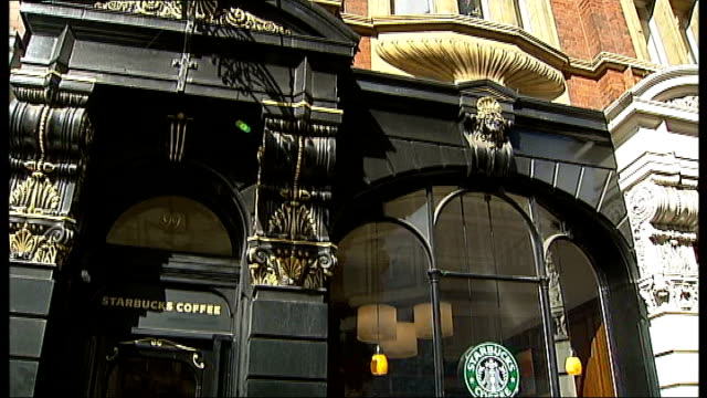 General internal and external views of Starbucks / exteriors of Caffe Nero and Pret EXT Sign for Smoothies outside cafe People sitting in cafe Long...