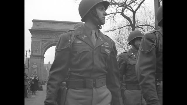stockvideo's en b-roll-footage met general james gavin gives paratroopers signal to begin marching in new york city victory parade crowd packed behind police barricade to side /... - 1946