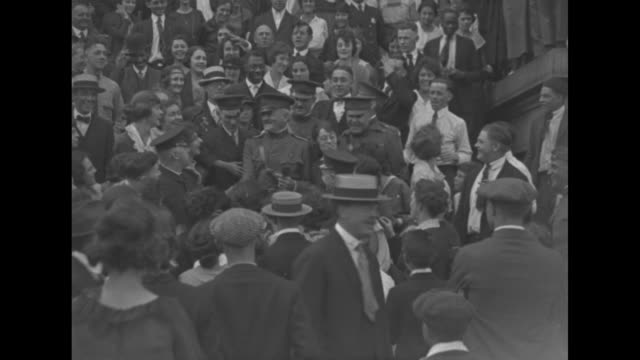 general john pershing gets out of car and walks past well wishers during his summons to washington dc after world war i / pershing and entourage walk... - 1910 1919 stock videos and b-roll footage