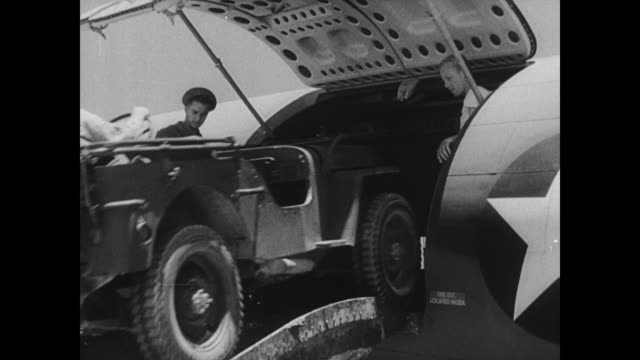 wwii general joseph stilwell watches as supply planes bring artillery jeeps and ammunition to chinese and american troops stationed along the ledo... - 多国籍軍点の映像素材/bロール
