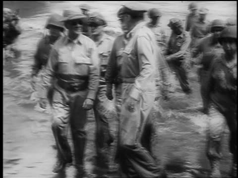 general macarthur group of officers wade in ocean on beach / leyte island phillipines - 1944 stock videos and b-roll footage
