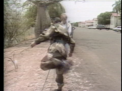 general manuel noriega steps over a small fence in panama during accusations of drug trafficking in the late 1980's. - crime or recreational drug or prison or legal trial 個影片檔及 b 捲影像
