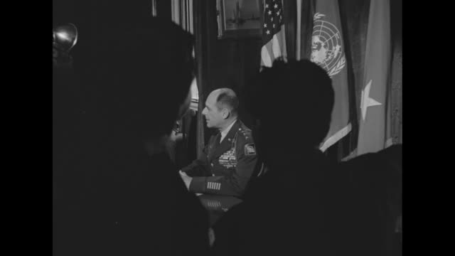 us general matthew b ridgway newly appointed commander of un forces in korea sits at desk surrounded by photographers and cameramen / several shots... - matthew b. ridgway stock-videos und b-roll-filmmaterial