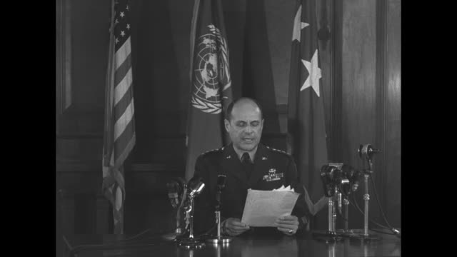 general matthew ridgway sits at desk in front of american united nations and united states army officer flags he holds papers / sot ridgway reads... - matthew b. ridgway stock-videos und b-roll-filmmaterial