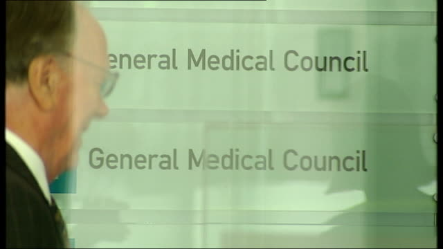 london ext entrance to the building housing the headquarters of the general medical council / woman seen inside reception area with general medical... - general medical council stock videos & royalty-free footage