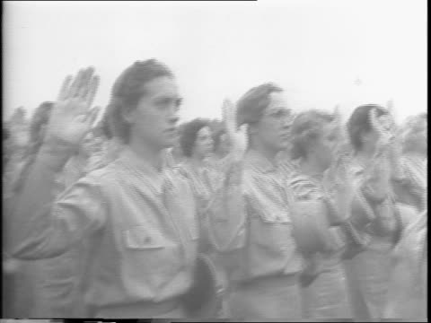 general miles on platform with rows of wacs in formation before him / miles from the front with right hand up administering oath / shots of wacs with... - anno 1943 video stock e b–roll