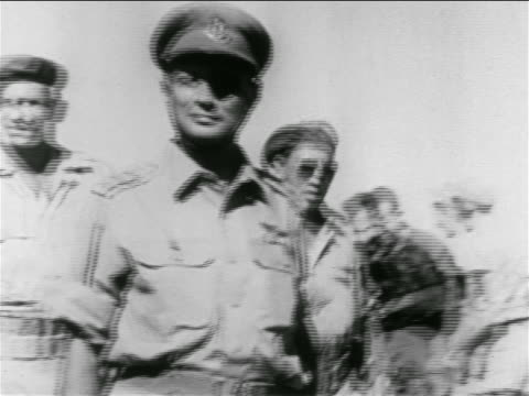 general moshe dayan + others walking past camera outdoors / suez crisis - israeli military stock videos & royalty-free footage