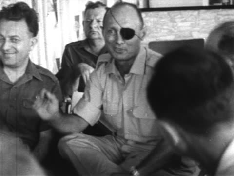 general moshe dayan with eyepatch sitting + talking with other men / newsreel - 1967 stock videos & royalty-free footage