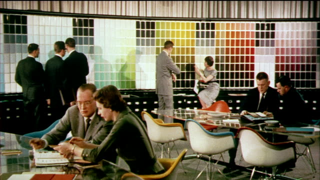 1958 MONTAGE CU MS WS General Motor design team conferencing with each other in room filled with color and material swatches