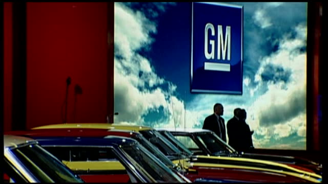 general motors announces cuts in car production int general motors stand at car show - general motors stock videos & royalty-free footage