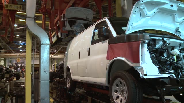 general motors workers assemble vans at factory van bodies are mounted on frame and transmission on september 14 2011 in wentzville missouri - general motors stock videos & royalty-free footage