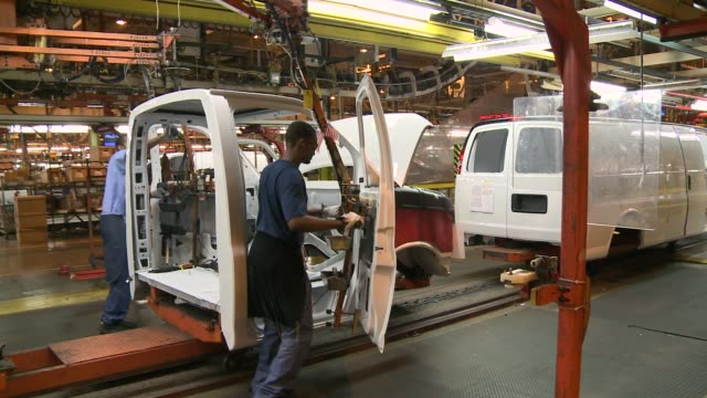general motors workers assemble vans at factory vehicles get interior equipment installed on september 14 2011 in wentzville missouri - general motors stock videos & royalty-free footage