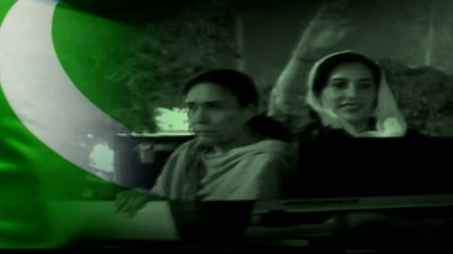 general musharraf pledges to hold elections early in 2008 pakistan islamabad flag / b/w benazir bhutto along in motorcade - pakistani flag stock videos & royalty-free footage