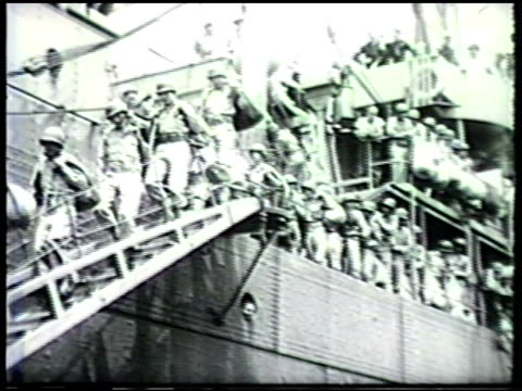 stockvideo's en b-roll-footage met s general of the army douglas macarthur standing amp watching vs us soldiers getting off transport ship in australia wwii world war ii pacific front - douglas macarthur