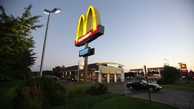 general outside broll of a mcdonald's restaurant in peru illinois on monday july 20 2015 shots wide shot of a mcdonald's restaurant as cars drive in... - mcdonald's stock videos & royalty-free footage