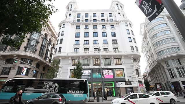 general outside view of the building of the pestana cr7 hotel located in the iconic gran via street on october 22, 2020 in madrid, spain. pestana cr7... - マドリード グランヴィア通り点の映像素材/bロール