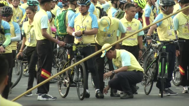 General Prayut Chanocha gets ready at the start of the 'Bike for Dad' event in Bangkok / Thai Crown Prince Maha Vajiralongkorn led thousands of...