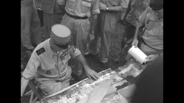 general raoul salan, outgoing commander of french far east expeditionary force / various shots of salan looking at aerial reconnaissance photos /... - laos stock videos & royalty-free footage