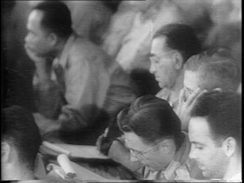 stockvideo's en b-roll-footage met general russell burton reynolds seated with war commission / tomoyuki yamashi conferring with officials in courtroom / close up of soldiers in... - mp