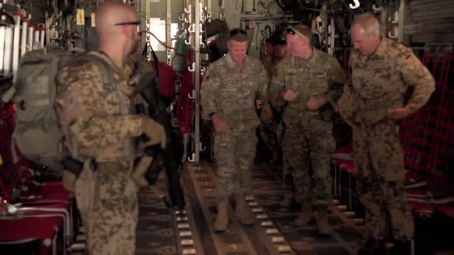 general scott miller, commander nato resolve support, walks off of military aircraft to meet other nato troops as us prepares to withdraw from... - us military stock videos & royalty-free footage