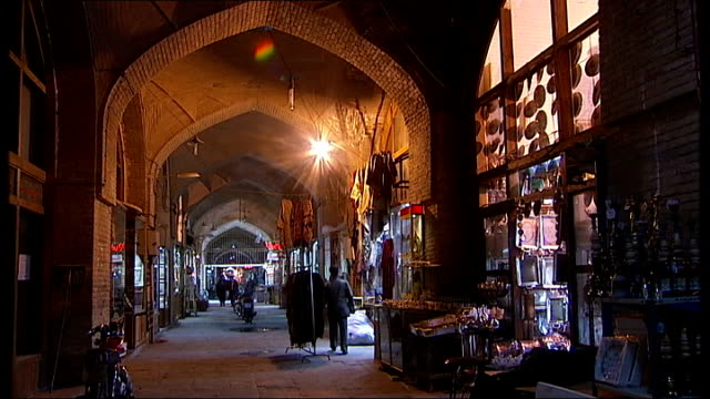 naghshi jahan square / shah mosque / market scenes / coffee shop int general views of people along inside market area various of people along past... - 中東点の映像素材/bロール