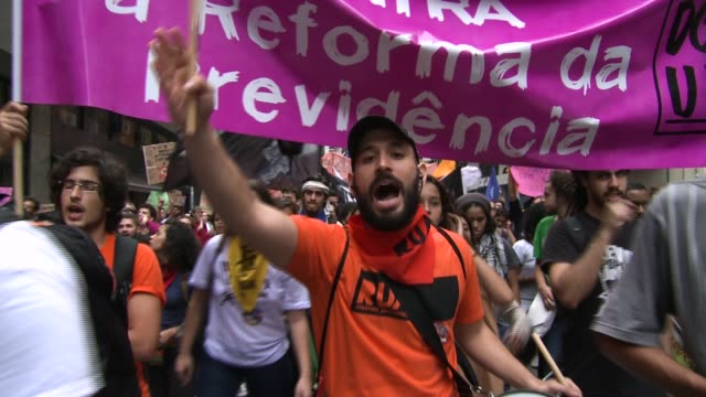a general strike in opposition to president michel temer's proposed legislative reform resulted in violence on the streets of rio de janeiro as... - protestor stock videos & royalty-free footage