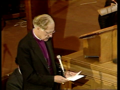 general synod votes to allow ordination of women priests itn london church house synod chamber tgv clergy seated at synod meeting pan robert runcie... - priest stock videos & royalty-free footage