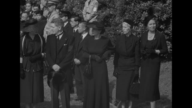 us general thomas hickey peggy ridgway and another woman walking through crowd in cemetery / up to tent / hickey and mrs ridgway standing under tent... - matthew b. ridgway stock-videos und b-roll-filmmaterial