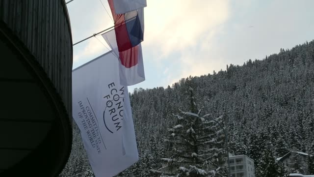 general view a sign sits on rooftop of the kongress hotel davos in davos, switzerland, on friday, jan. 17 general view barbed wire, national flags... - annual general meeting stock videos & royalty-free footage