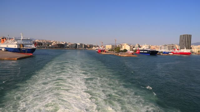 stockvideo's en b-roll-footage met general view at athens main harbor piraeus during a ferry departure on august 8 2020 in athens greece first port and main industrial center of greece... - veerboothaven