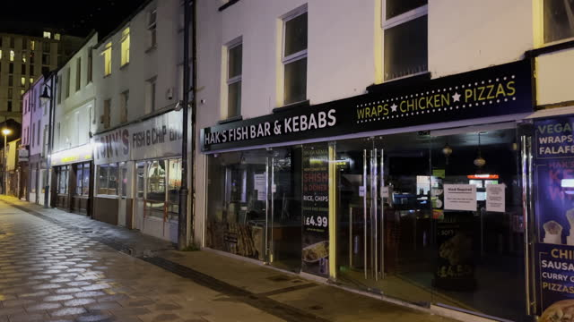 """general view closed takeaway restaurants on caroline street in cardiff city centre on the first saturday night of the """"firebreak"""" which is aimed at... - cafe stock videos & royalty-free footage"""