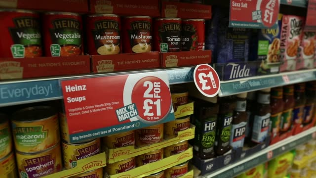 general view customers browse goods inside a poundland discount store operated by poundland group plc in london uk on friday march 7 a woman shopper... - portionspåse bildbanksvideor och videomaterial från bakom kulisserna