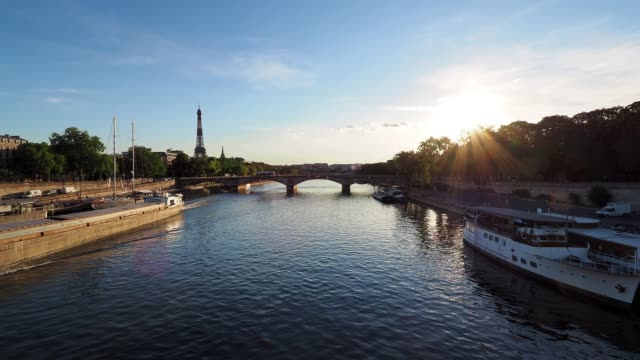 general view from the alexander iii bridge of the seine river during sunset on may 20 2020 in paris france the coronavirus pandemic has spread to... - wolkenloser himmel stock-videos und b-roll-filmmaterial