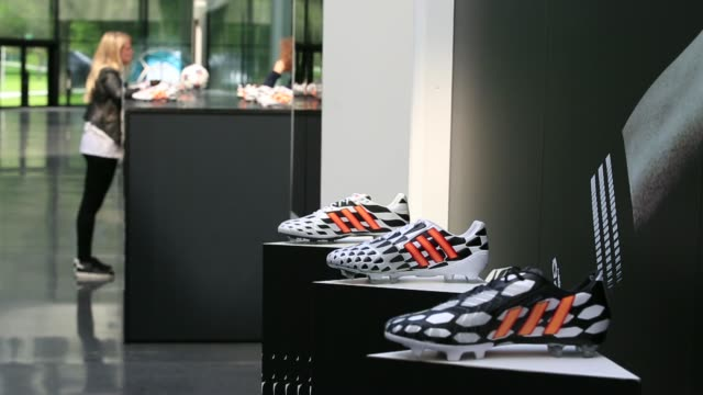 general view interior of adidas ag headquarters in herzogenaurach germany on thursday may 15 the adidas stripes logo sits on soccer boots on display... - logo stock videos & royalty-free footage