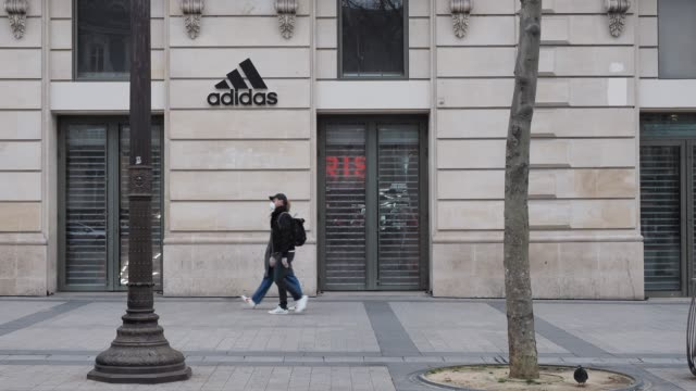 general view of a closed adidas store, at avenue des champs elysees, in the 8th quarter of paris, as the city imposes emergency measures to combat... - adidas stock videos & royalty-free footage