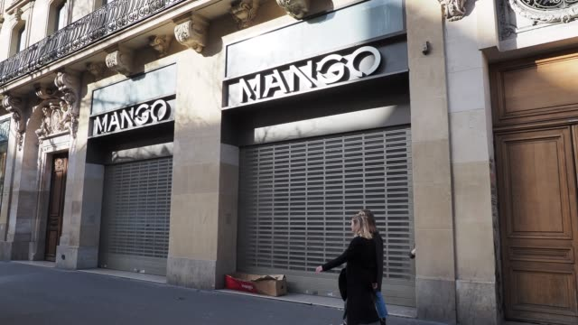 general view of a closed mango store in the 9th quarter of paris, on march 15, 2020 in paris, france. french prime minister edouard philippe... - number 9 video stock e b–roll