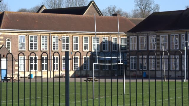 general view of a closed school as the uk government closes schools and tells the public to stay at home and avoid all non essential travel in a bid... - school building stock videos & royalty-free footage