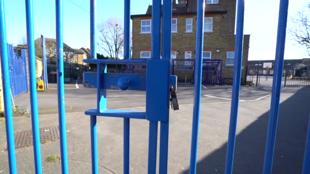 march 23: general view of a closed school as the uk government closes schools and tells the public to stay at home and avoid all non essential travel... - closing stock videos & royalty-free footage