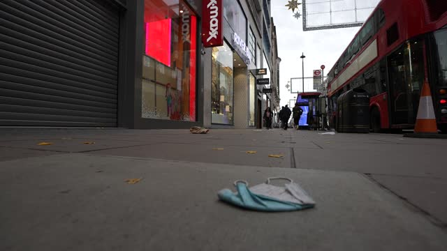 general view of a discarded face mask littering the street on oxford street during lockdown 2.0 on november 16, 2020 in london, england. england... - general view stock videos & royalty-free footage