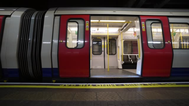 march 24: general view of a district line train pulling into hammersmith station as the uk government tells the public to stay at home and avoid all... - pulling stock videos & royalty-free footage