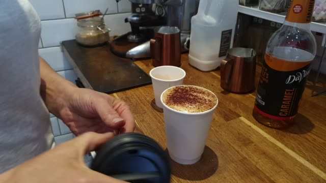 general view of a drink being prepared at sista barista, a black female family run coffee shop near waterloo station on july 16, 2020 in london,... - coffee drink stock videos & royalty-free footage