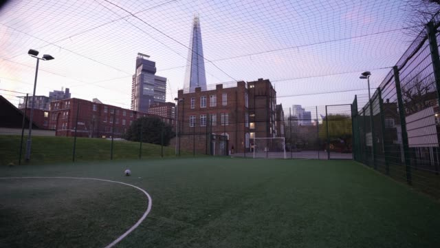 general view of a five a side football pitch as british prime minister boris johnson announced strict lockdown measures urging people to stay at home... - side view stock videos & royalty-free footage