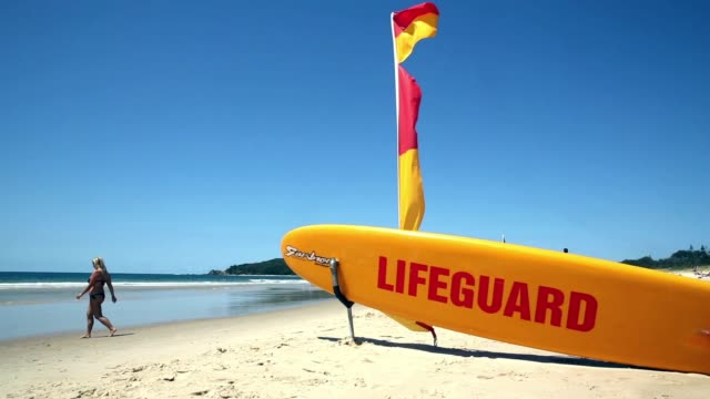a general view of a lifeguard rescue board on october 10 2014 in byron bay australia byron bay council has voted provide yearround lifeguard patrols... - bagnino video stock e b–roll